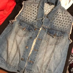 Jean studded vest with distressed cross